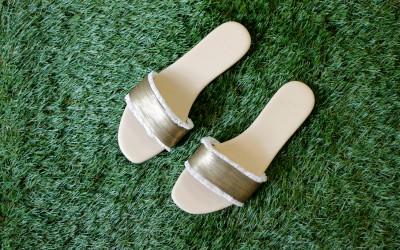 HALSTON Gold Flat Sandal
